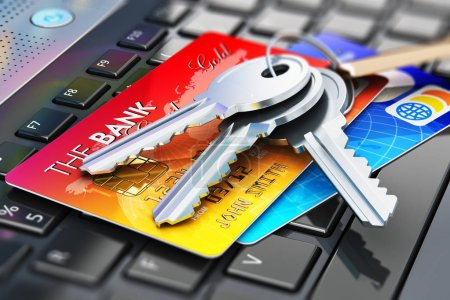 Credit cards and house keys on laptop keyboard