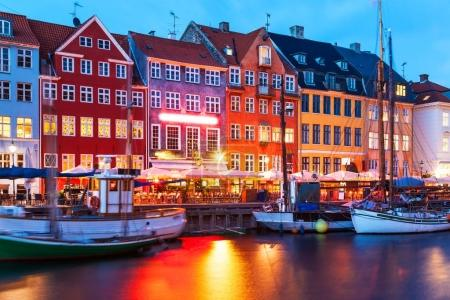 Photo for Scenic evening panorama of famous Nyhavn pier architecture in the Old Town of Copenhagen, Denmark - Royalty Free Image