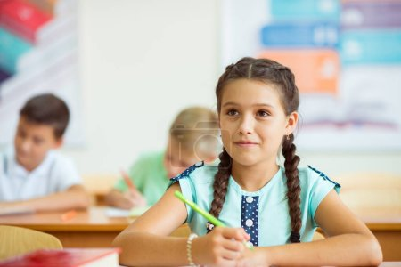 Photo for Portrait of children studying in classroom at the school - Royalty Free Image