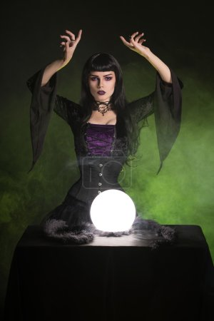Beautiful fortune teller wearing gothic style