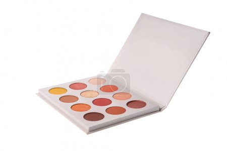 Fashionable eye shadow palette in warm colors, isolated on white background