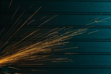 Close-up shot of angle grinder sparks