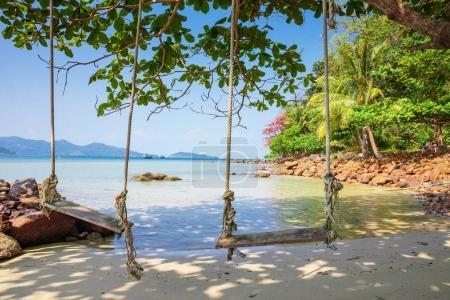 Seesaw on sand beach