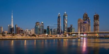 DUBAI, UAE - NOVEMBER 29, 2017: Dubai water channel at night in district area Business Bay.