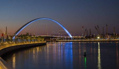 DUBAI, UAE - NOVEMBER 29, 2017: Dubai Water Canal arch bridge at night