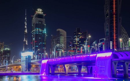 DUBAI, UAE - NOVEMBER 29, 2017: Colorful illuminated Waterfall. The Waterfall is part of the Dubai Water Canal development.