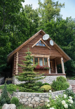 Chalet from logs in forest