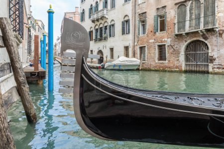 Venice, Italy - JUNE 26, 2014: closeup of gondola on canals of Venice.