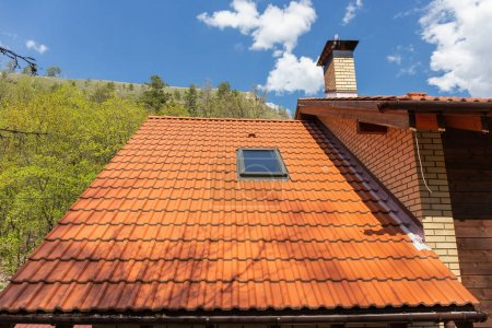 Tiled red roof with attic window