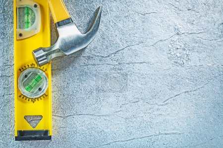 Claw hammer construction level on abstract metallic background b
