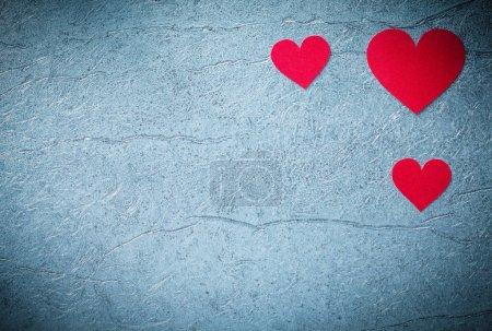 Red hearts on metallic background Valentine card