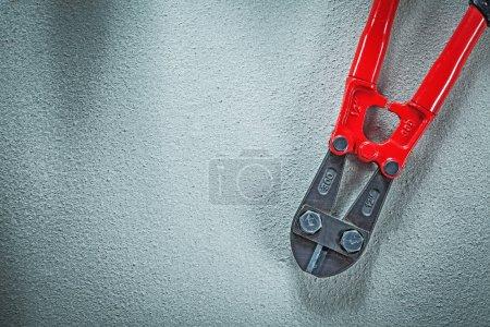 Steel cutter on concrete background construction concept