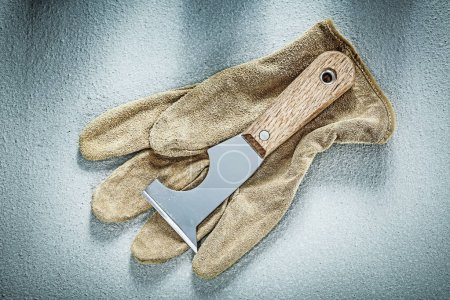 Plastering trowel safety gloves on concrete surface construction