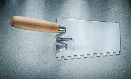 Bricklaying trowel on concrete background construction concept