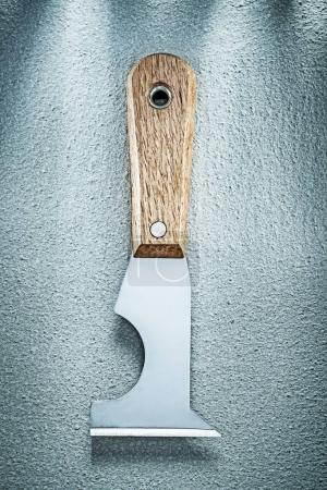 Construction spatula on concrete surface directly above building