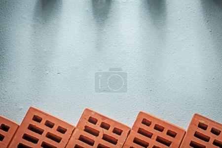 Collection of red bricks on concrete surface construction concep