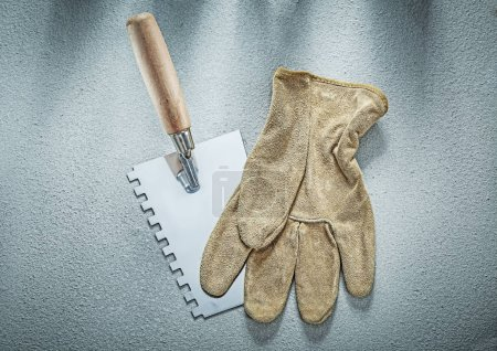 Paint scraper safety gloves on concrete surface construction con