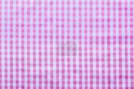 Pink checked cotton background top view