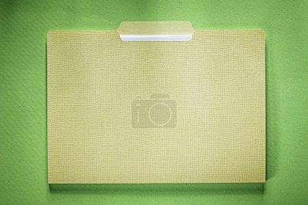 Office folder on green background