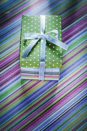 Decorated present box on striped tablecloth celebrations concept