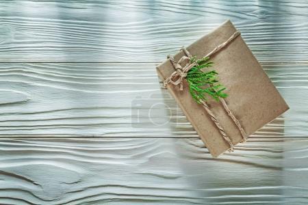 Handmade gift box with green thuya branch top view celebrations