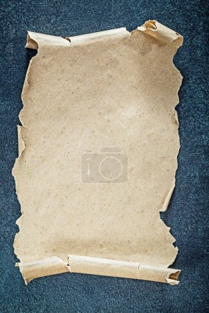 Vintage blank paper sheet on black background