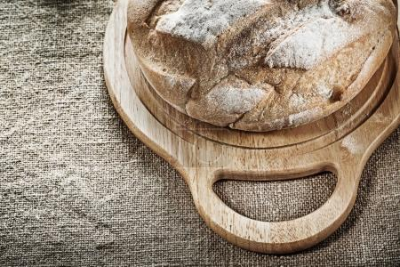 Carving board bread on sacking background