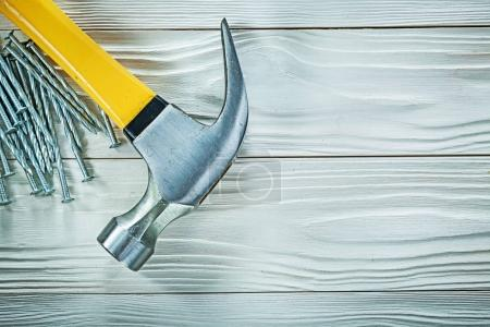 Photo for Claw hammer construction nails on wood board. - Royalty Free Image