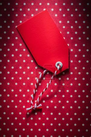 Red sale tag on polka-dot background