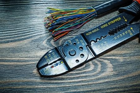 Electric wires insulated stripper on wooden board