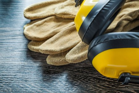 Protective gloves noise reduction earmuffs on black board