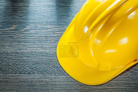 Protective hard hat on wooden board