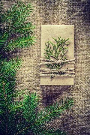 Present box thuya fir tree branch on bagging background