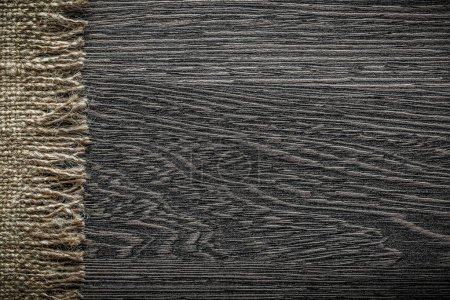 Vintage burlap cloth on wooden board