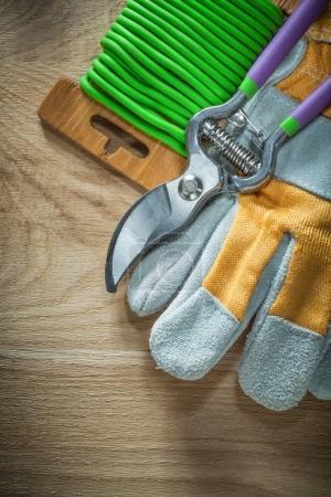 Garden pruner garden soft twist tie safety gloves on wooden boar