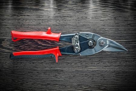 Stainless steel cutter on wooden board