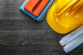 Construction drawings building helmet notepads pen on wood board