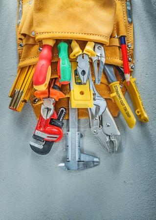Photo for Leather tool belt construction tooling on concrete background. - Royalty Free Image