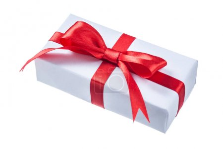 White present box with red bow isolated on white