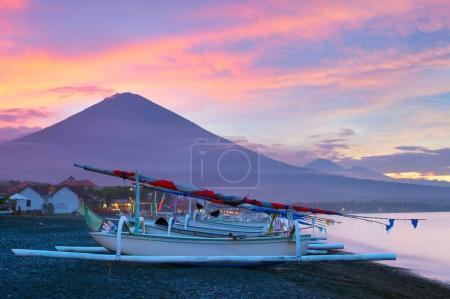 Volcano, ocean, fishing boats