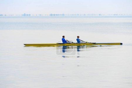 Teenagers rowing in kayak