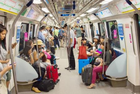 Passengers in Singapore Mass Rapid Transit