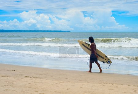 Surfers relaxing with surfboard