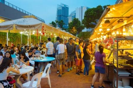SINGAPORE - JAN 14, 2017 : People at popular food court in Singapore. Inexpensive food courts are numerous in the city so most Singaporeans dine out at least once a day.