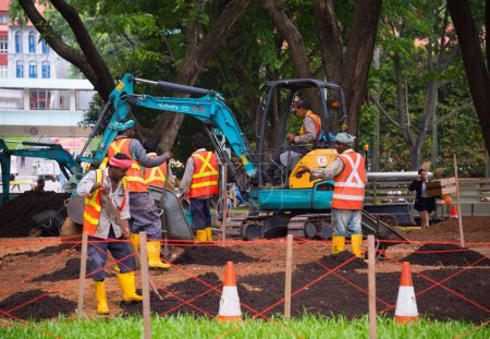 Workers work in public park