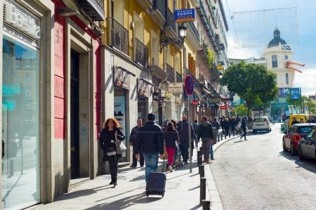 MADRID, SPAIN - NOV 07, 2017: People walking by the Old Town street of Madrid. Madrid is a popular tourism destinations with 3.9 million estimated annual visitors