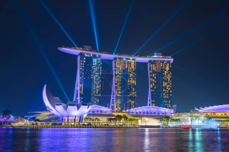 SINGAPORE - JAN 14, 2017: Marina Bay Sands Resort performing lights show at night. It is billed as the world's most expensive standalone casino property at S$8 billio