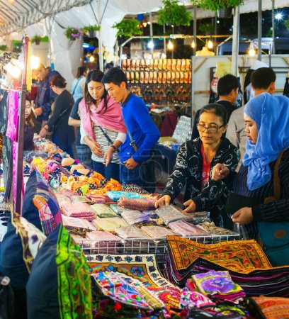 CHIANG MAI, THAILAND - JANUARY 11TH, 2017: People at a Night Market in Chiang Mai. Chiang Mai is a second largest city of Thailand. Famous tourist destination