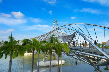 SINGAPORE - FEBRUARY 17, 2017: The Helix Bridge in Singapore. Is a bridge in the Marina Bay. The Helix is fabricated from 650 tonnes of Duplex Stainless Steel and 1000 tonnes of carbon steel.