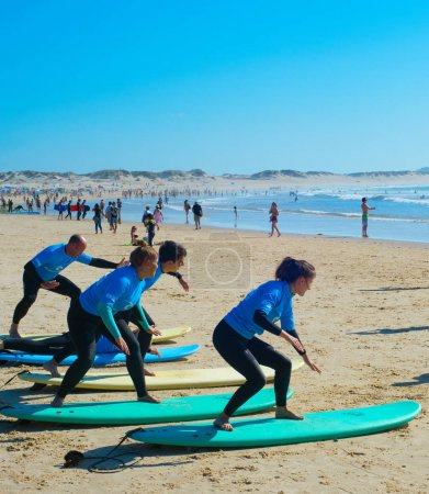 BALEAL, PORTUGAL - JUL 30, 2017: Coach show how to surf to the group of surfers. Ericeira is the famous surfing destination in Portugal.